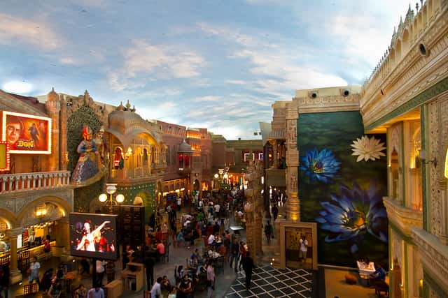 People strolling through the culture gully at Kingdom of Dreams