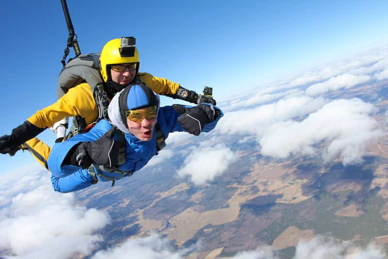 An instructor and a student in a tandem skydive jump