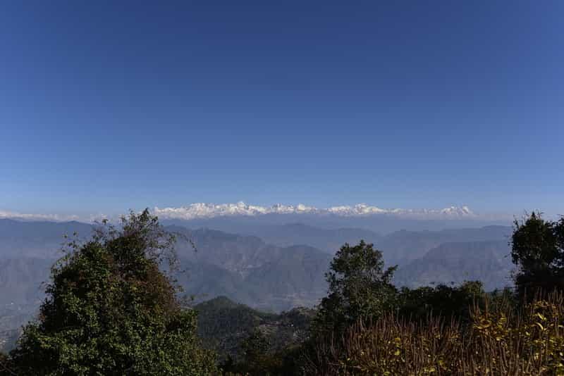 Enjoy stunning views of the snow clad Himalayas from Kanatal