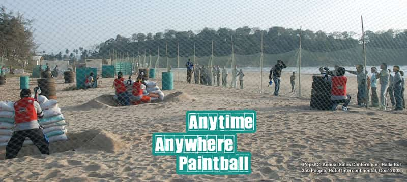 Visitors engaged in a game of paintball