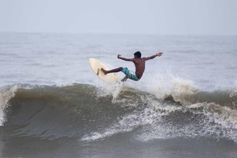 A surfer on Covelong Beach