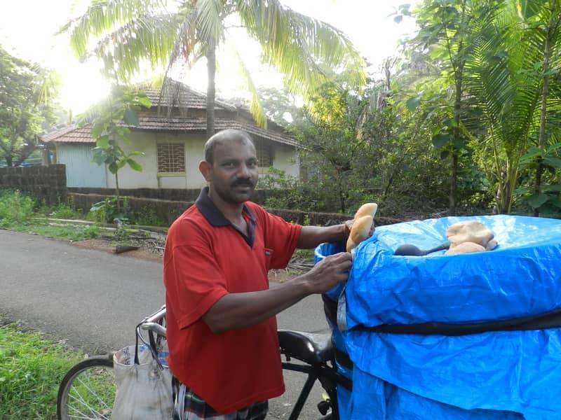 A bread man selling Poi in Goa