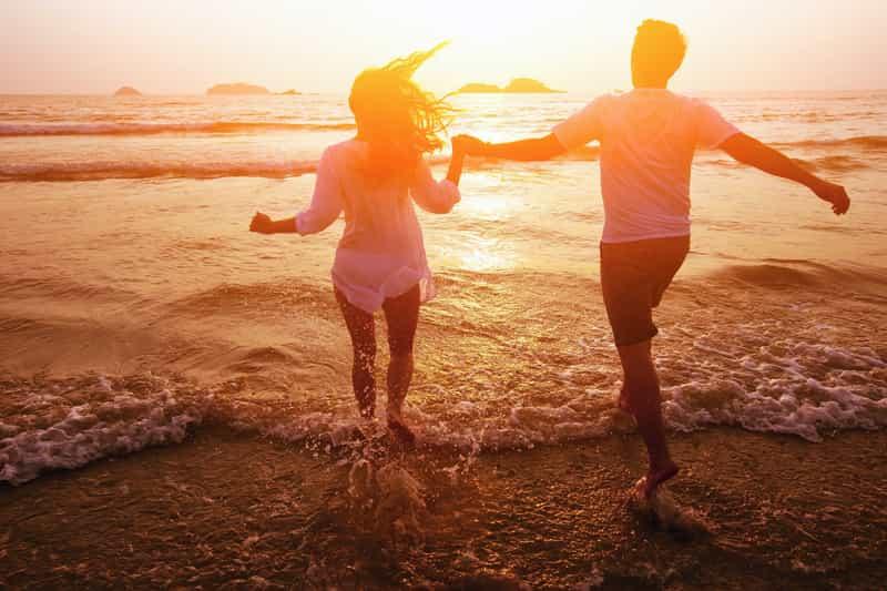 A couple enjoying a romantic walk on the beach