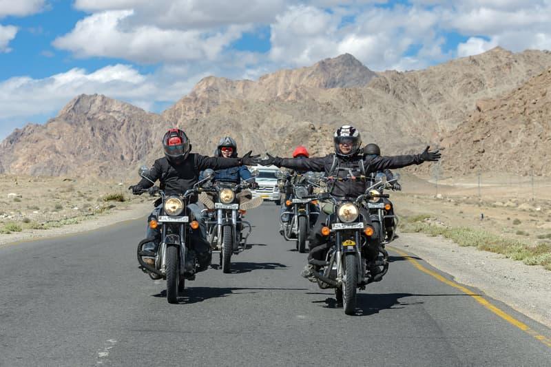 Bikers driving through mountains in Ladakh