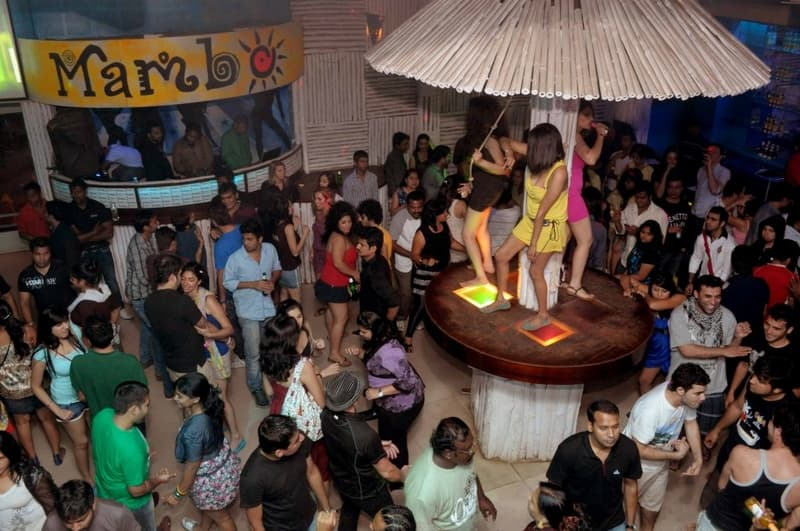 Party with a fun-loving crowd at Café Mambos