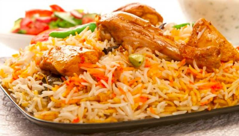 Relish delicious biryani at Al Madina in Hyderabad