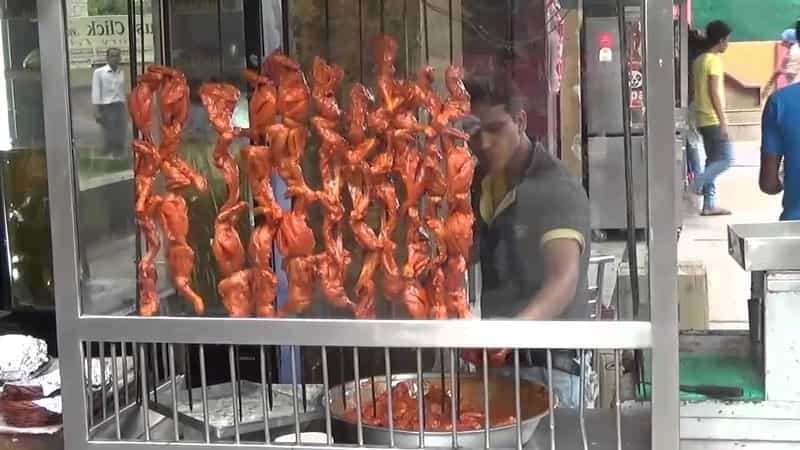 Tandoori being prepared at a stall