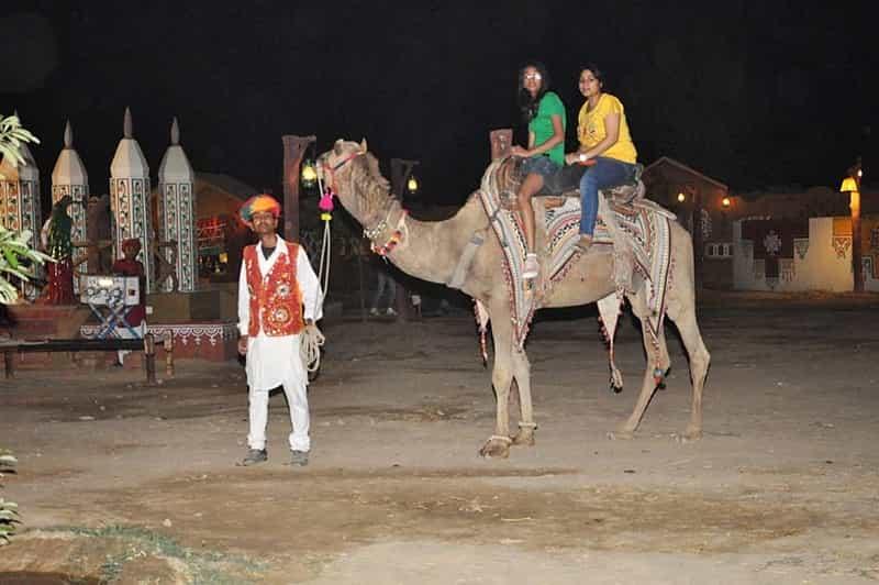 Patrons enjoying a camel ride
