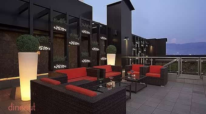 Enjoy the beautiful views with your partner at this rooftop eatery