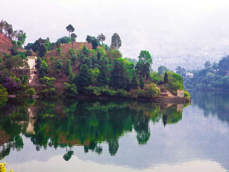 Soak in the lovely ambiance at the Naukuchiatal lake