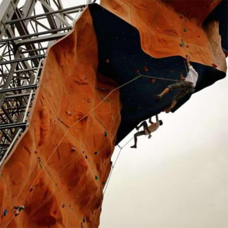 Patrons climbing the artificial wall