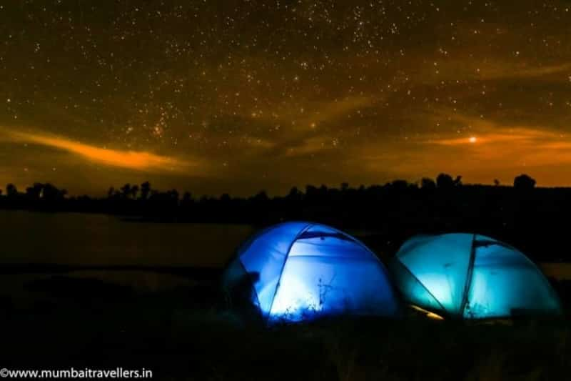 Tents set up during a beautiful starry night at Vaitarna