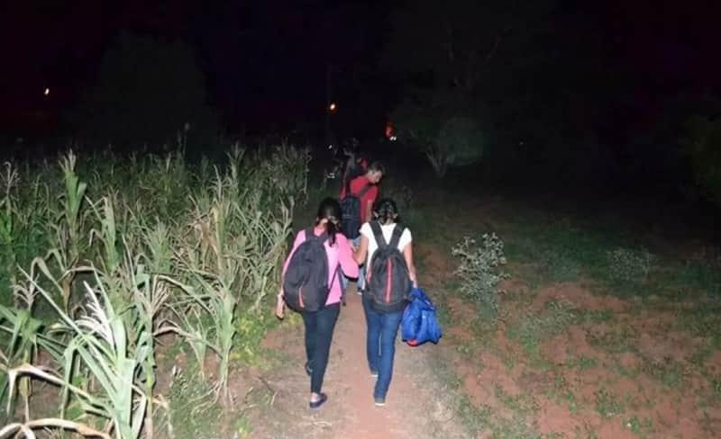 Trekkers going through a field in Ramanagara