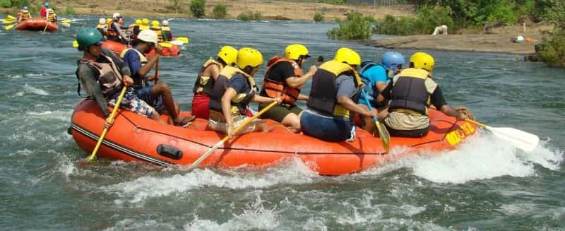 Visitors engaged in a rafting exercise
