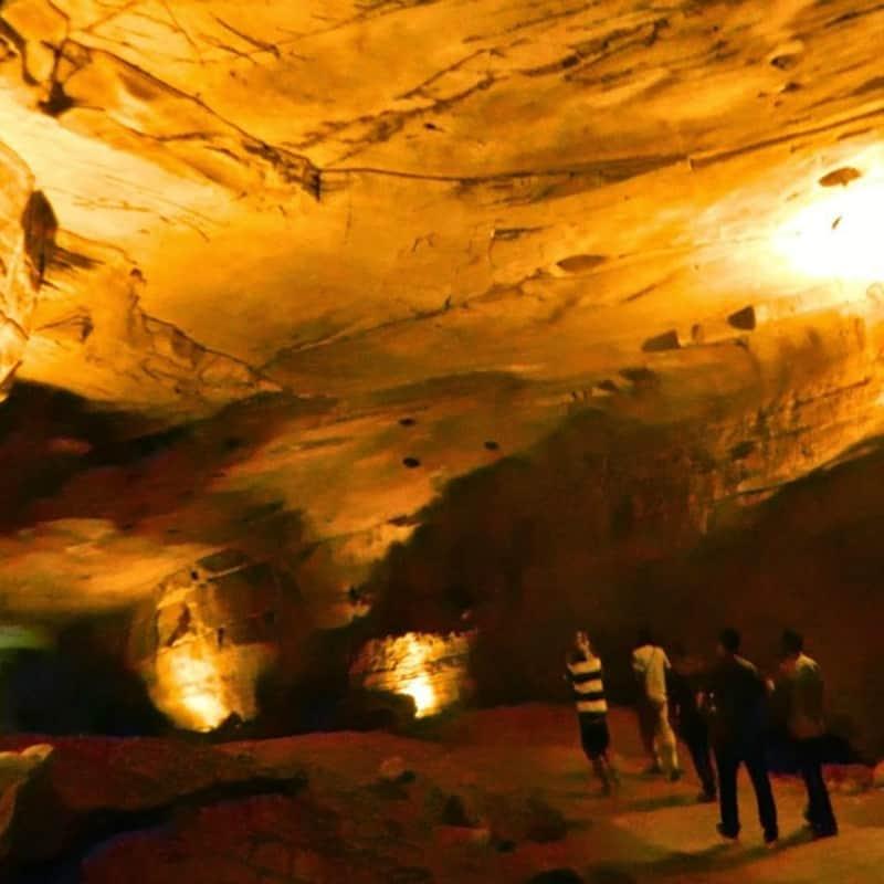 Visitors trekking in the caves of Antargange