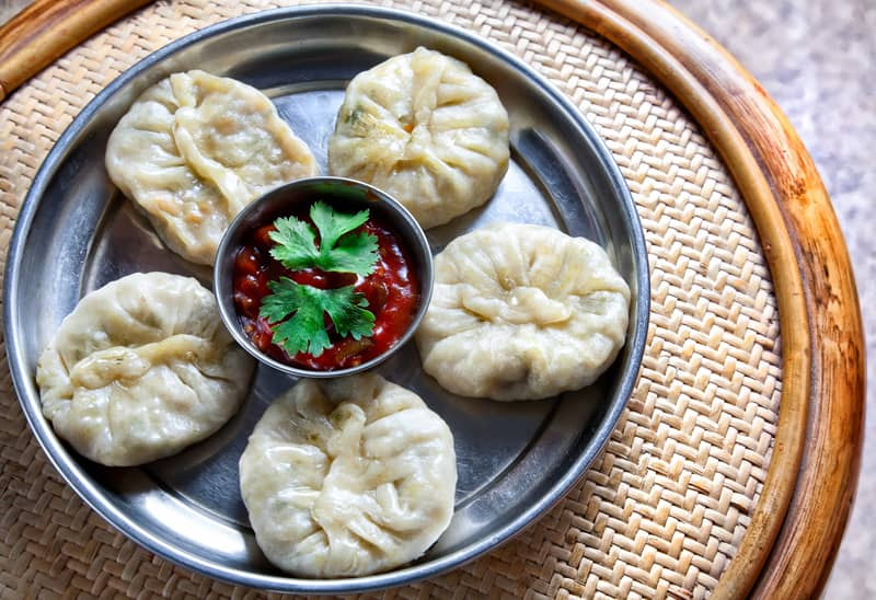 Momos served with sauce in a Platter